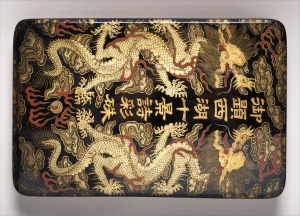 Lacquer box with lid decorated with gold dragons on a black background